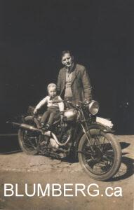 Henry and his father Julius on Julius' motor cycle.